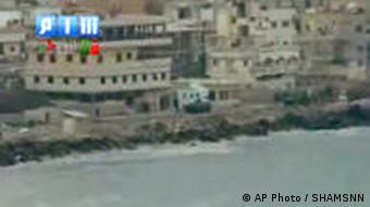In this image taken from video made available Sunday Aug. 14, 2011, by Shaam News Network (SHAMSNN), in which they purport to show armoured vehicles as they take up positions along the water front of Latakia, Syria. The intense operation in Latakia, a key port city once known as a summer tourist draw, is part of a brutal government crackdown on several Syrian cities meant to root out protesters demanding the ousting of President Bashar Assad. (AP Photo / SHAMSNN) EDITORIAL USE ONLY - THE ASSOCIATED PRESS HAS NO WAY OF INDEPENDENTLY VERIFYING THE CONTENT, LOCATION OR DATE OF THIS VIDEO IMAGE.