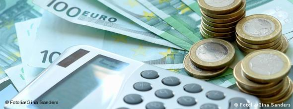A calculator with euro banknotes and coins
