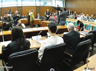Arid U. sitting in court