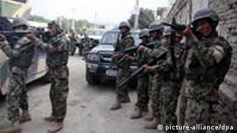 Afghan soldiers take position at the scene after several armed Taliban militants launched attacks in Kabul, Afghanistan, on 13 September 2011. Several Taliban suicide bombers were hold up in a multi-storey building near several foreign embassies, launched attacks, that also targeted NATO's International Security Assistance Force (ISAF) headquarters.