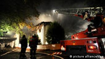 Firefighters battling the blaze at Breno's house