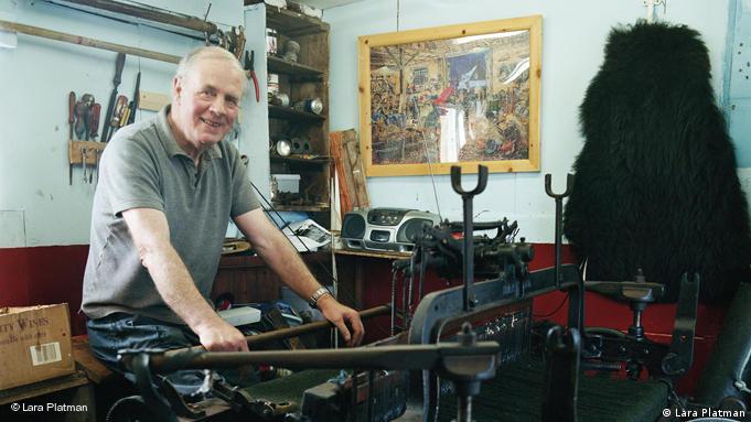 Norman Mackenzie operates his loom