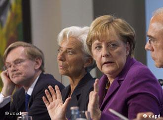 OECD President Angel Gurria, German Chancellor Angela Merkel, World Monetary Fund President Christine Lagarde and World Bank President Robert Zoellick, from right, address a news conference after a meeting at the chancellery in Berlin, Thursday, Oct. 6, 2011. (AP Photo/Markus Schreiber)