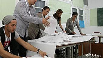 election officials counting ballots in Tunisia