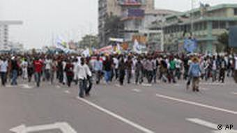 Opposition supporters march in protest against alleged fraud in the run up to November elections, in Kinshasa, Congo, Thursday, Sept. 1, 2011. Police fired tear gas Thursday at hundreds of stone-throwing opposition supporters demonstrating in Congo's capital. Jacquemain Shabani, the opposition party's secretary-general, said Thursday that they want an audit of the electoral register, alleging there was fraud during enrollment. (AP Photo/John Bompengo