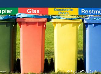 Row of four different-colored bins for recycling different materials, outside in Germany