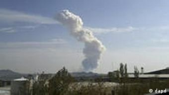 Smoke rises from an explosion at a Revolutionary Guard ammunition depot outside Bidganeh village, west of Tehran