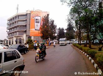 Outside the UTC in Kigali Outside the Union Trade Centre in Kigali that house the Nakumat supermarket, Rwandair et al. From Dieses Foto wurde am 4. September 2009 mit einem Apple iPhone aufgenommen. Creative Commons Lizenz, Namensnennung, nicht-kommerzielle Nutzung