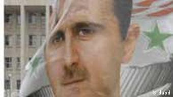 A poster showing the image of Syrian President Bashar al-Assad
