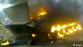 In this image from amateur video made available by the Ugarit News group on Tuesday Nov. 15, 2011 shows a a burning Syrian tank in Daraa, Syria on Monday Nov. 14, 2011. (Foto:Ugarit vai APTN/AP/dapd) TV OUT THE ASSOCIATED PRESS CANNOT INDEPENDENTLY VERIFY THE CONTENT, DATE, LOCATION OR AUTHENTICITY OF THIS MATERIAL. TV OUT
