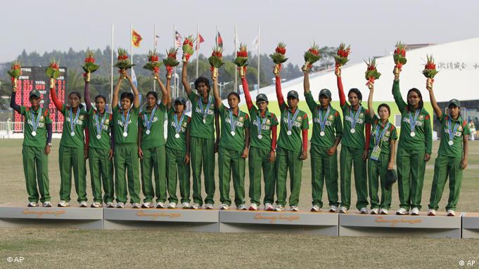 The Bangladesh team wave from the podium after receiving their silver medal in the women's cricket at the 16th Asian Games in Guanghzou, China, Friday, Nov. 19, 2010. Pakistan defeated Bangladesh by ten wickets. (AP Photo/Mark Baker)