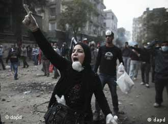 A protester gestures during clashes with Egyptian riot police near the interior ministry in downtown Cairo