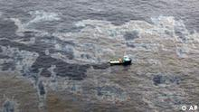 This photo taken Nov. 18, 2011 and released by Rio de Janeiro's government, shows an aerial view of a boat crossing an area of the oil spill in an offshore field operated by Chevron at the Bacia de Campos, in Rio de Janeiro state, Brazil. Rio de Janeiro state's environment secretary, Carlos Minc, says Brazil is expected to fine Chevron nearly $28 million for the ongoing offshore oil spill and will also ask Chevron to pay for damages caused by the Atlantic spill. Minc said Monday he considers the fine way too lenient, but it's the maximum allowed under current Brazilian law. (AP Photo/Rio de Janeiro's government,Rogerio Santana)