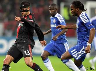 Didier Drogba (R) and Michael Ballack vie for the ball