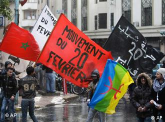 Anti-government protesters hold the Moroccan national flag, left, and the 20th February movement flag in red black and white during a rally organized by the 20th February, the Moroccan Arab Spring movement in Casablanca, Morocco, Sunday, Nov 20, 2011 Copyright: AP Photo/Abdeljalil Bounhar