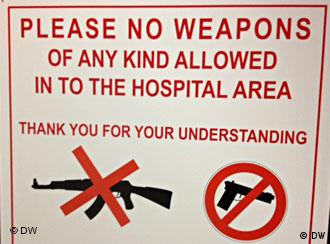 Sign saying no weapons of any kind allowed in the hospital area