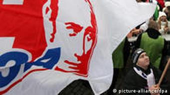 Activists of the pro-Kremlin youth movement Nashi hold flags with portraits of Russian Prime Minister Vladimir Putin