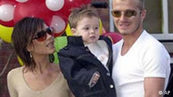 David Beckham (far right) with his wife Victoria Beckham and their son Brooklyn