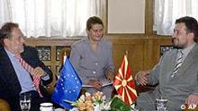 EU foreign policy chief Javier Solana, left, talks with Macedonian Prime Minister Ljubco Georgievski, right, in presence of an unidentified translator in the middle, in Skopje, on Thursday, Sept. 5, 2002. Solana arrived in Macedonia to talk with Macedonian top officials and party leaders shortly before the Parliamentary elections in this Balkan country, scheduled for Sept. 15. (AP Photo/Boris Grdanoski)