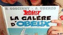 American's Samuel and Alexandra Ewenczyk, living in France, read the last comic book of Asterix Obelix's Galley Ship Friday, October 11, 1996 in Paris. Kids and adults alike, raised the adventures of the diminutive Gallic hero and his sidekick, Obelix, snapped up copies of the book. Some bookstores were sold out, as the new 48-page album ended a five-year silence by creator Alber Uderzo.(AP PHOTO/Gael Cornier)