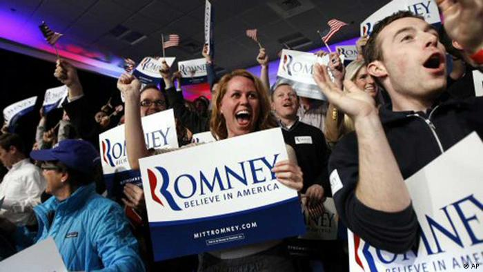 Supporters of Republican presidential candidate, former Massachusetts Gov. Mitt Romney, cheer as it was declared that he was the winner of the New Hampshire primary rlection