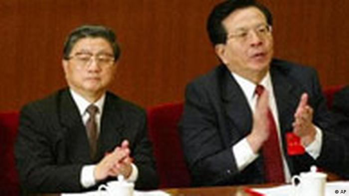Former Shanghai Party Secretary Huang Ju, left, and Zeng Qinghong, a close aide to President Jiang Zemin, listen to Jiang's speech at the opening session of the Communist Party's 16th National Congress in Beijing's Great Hall of the People Friday, Nov. 8, 2002. Both are rumored to be contenders for senior leadership positions in the Congress under way this week.