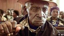 88-year-old Robert Molapo attends an announcement of a lawsuit against international banks and companies in Johannesburg Tuesday Nov. 12, 2002. The South African support group for victims of apartheid said it was filing a suit in the U.S. federal court in New York seeking damages for victims from organisations which supported the past racist regime.