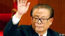 Chinese President Jiang Zemin raises his hand to support a motion during the closing ceremony of the 16th Communist Party Congress in Beijing Thursday Nov. 14, 2002. China confirmed Thursday that Jiang would retire as Communist Party leader, with a new General Secretary to be announced Friday. (AP Photo/Greg Baker)