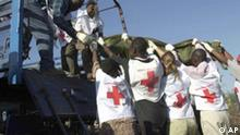 Members of the Red Cross remove bodies from the Paradise Hotel, in Kikambala, near Mombasa , Thursday Nov. 28 , 2002 after it was devastated by a car bomb. In simultaneous attacks on Israeli tourists in Kenya, a car bomb exploded at the Israeli-owned hotel on Thursday, killing 11 people, and at least two missiles were fired at - but missed -an Israeli airliner that had just departed the city of Mombasa. The hotel explosion killed six Kenyans, two Israelis and three people who were insides a vehicle that crashed through the Paradise Hotel's barrier and rammed into its reception area before exploding.(AP Photo/Karel Prinsloo)