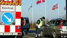 Danish police check a vehicle at the Danish-German border at Froeslev Tuesday Dec.10, 2002. Due to the upcoming European Union Summit in Copenhagen Thursday and Friday mandatory passport control has been re-established. (AP Photo/Nordfoto/Claus Fisker) ** DENMARK OUT **