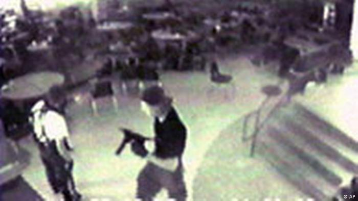 Overhead closed circuit tv footage shows the gun-toting shooters Eric Harris and Dylan Klebold in the school cafeteria.