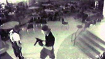 Eric Harris, left, and Dylan Klebold, carrying a TEC-9 semi-automatic pistol, are pictured in the cafeteria at Columbine High School, in Littleton, Colo., during their April 20, 1999 shooting rampage where they killed a teacher and 12 students. Both gunmen killed themselves later in the school library. This still image is from a videotape released by the Jefferson County Sheriff's Department. Jefferson County District Judge Brooke Jackson ordered the tapes released late last month, along with copies of law-enforcement radio transmissions. The releases were requested by the families of slain students Kelly Fleming and Daniel Rohrbough, who have sued the sheriff's office. (AP Photo/Jefferson County Sheriff's Department)