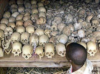 A man in Nyamata, 18 miles south of Kigali looks at hundreds of skulls, Jan. 26, 2002, at a memorial for victims of the 1994 genocide in Rwanda. More than 500,000 Tutsis and politically moderate Hutus were killed in the genocide and memorials have been built all over the central African nation to help the country's reconciliation process. (AP Photo/Saurabh Das