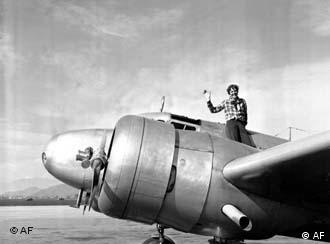 American aviatrix Amelia Earhart waves from the Electra (AP Photo)