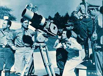 Leni Riefenstahl looking through director