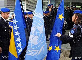 The European Union police officer Maria Donk from Netherlands is carrying an EU flag during a ceremony in the Bosnian capital of Sarajevo