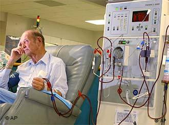 Man sitting in recliner next to dialysis machine