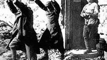 Two German soldiers surrendering in 1943