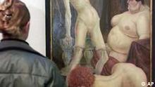 Das Gemaelde Drei Weiber von Otto Dix betrachtet eine Frau am Donnerstag, 17.Januar 2002 in der Gallerie der Stadt Stuttgart. Zusammen mit 30 Arbeiten des Amerikaners Duane Hanson sind 15 Gemaelde von Otto Dix in der Ausstellung More than reality vom 19.Januar bis 28.April 2002 zu sehen. (AP Photo/Thomas Kienzle)