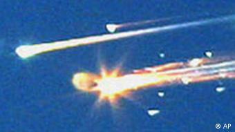 Debris from the space shuttle Columbia streaks across the sky over Tyler, Texas, Saturday, Feb. 1, 2003. Amateur photographer Dr. Scott Lieberman shot a series of photos showing the break-up of the space shuttle from his backyard in Tyler early Saturday. Space shuttle Columbia broke apart in flames 200,000 feet over Texas on Saturday, killing all seven astronauts just minutes before they were to glide to a landing in Florida. (AP Photo/Tyler Morning Telegraph, Dr. Scott Lieberman) ** COPYRIGHT DR. SCOTT LIEBERMAN, MAGAZINES OUT, TV OUT, MANDATORY CREDIT **