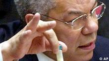 U.S. Secretary of State Colin Powell holds up a vial that he said could contain anthrax as he presents evidence of Iraq's alleged weapons programs to the United Nations Security Council Wednesday, Feb. 5, 2003. (AP Photo/Kathy Willens)
