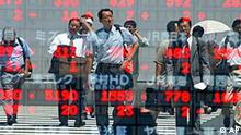 Japanese businessmen are reflected on the display of stock prices as they cross an intersection in downtown Tokyo Friday, Aug. 9, 2002. Share prices in Asia soared in early Friday trading, welcoming the rally overnight on Wall Street that helped allay worries in the region about a shaky economic recovery and a volatile stock market across the Pacific.