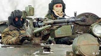 masked soldiers in a tank