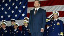Secretary of Homeland Security Tom Ridge stands during a ceremony to transfer the U.S. Coast Guard to his agency from the Transportation Department, at the D.C. Armory in Washington, Tuesday, Feb. 25, 2003. The Coast Guard and over 20 federal agencies were reorganized into the new Homeland Security Department in response to the terrorist threat against the United States. (AP Photo/J. Scott Applewhite)