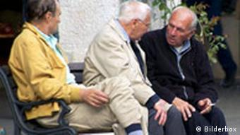 Three older men on a bench
