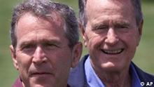 Former President George Bush smiles as his son Texas Gov. George W. Bush talks to reporters at their family compound at Walker's Point in Kennebunkport, Maine, Sunday June 13, 1999.(AP Photo/Eric Draper)