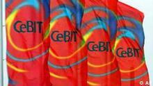 Fahnen mit dem CeBIT-Logo wehen vor einem Eingang zum Messegelaende in Hannover am Montag, 10. Maerz 2003. Rund 6.500 Aussteller zeigen ihre Neuheiten vom 12. bis 19. Maerz auf der weltgroessten Messe fuer Informations- und Telekommunikationstechnik CeBIT in Hannover. (AP Photo/Eckehard Schulz) --- Flags displaying the CeBIT logo fly in front of an entrance of the fair ground in Hanover, northern Germany, March 10, 2003. Some 6.500 exhibitors will present their latest products at the world's largest fair for telecommunications and information technology CeBIT from March 12 until 19, 2003. (AP Photo/Eckehard Schulz)