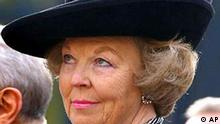 Dutch Queen Beatrix looks up in this March 4, 2003 photo taken in in The Hague, Netherlands. The ongoing Dutch royal family feud played out on national television on Wednesday after Princess Margarita accused Queen Beatrix's family of abusing power and threatened to sue for allegedly damaging her husband's business. (AP Photo/Dusan Vranic)