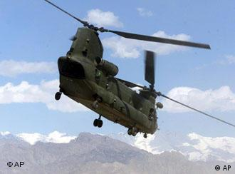 A British Royal Airforce Chinook helicopter takes off from Bagram Air Base