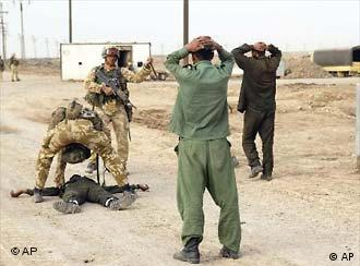 Taking prisoners: British soldiers in southern Iraq on Friday.